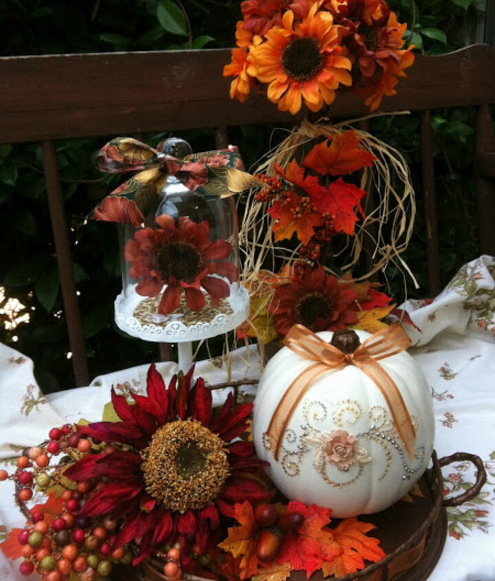 The last step was to finish it off with a ribbon bow by pushing a floral pin through the bow into the pumpkin.  This is such a simple project to create a detailed, glammed up pumpkin!