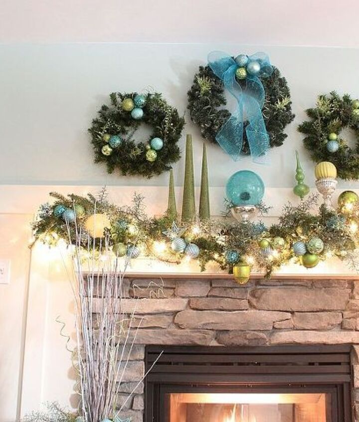 A trio of wreaths above the mantle.
