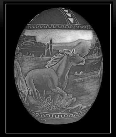 Mustangs. This is an intaglio carving and lit from the inside. It's carved like you would carve a mold, inverted. The outside image is like a negative. When lit from the inside the image appears possitive