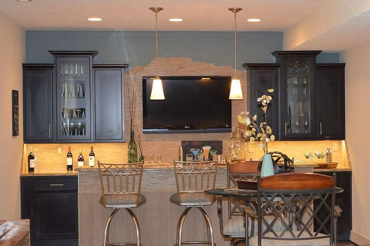 an entertaining basement remodel, basement ideas, entertainment rec rooms, home improvement, The maple cabinets with onyx finish anchor the space while the lighter finish on the island keeps the space from being too dark