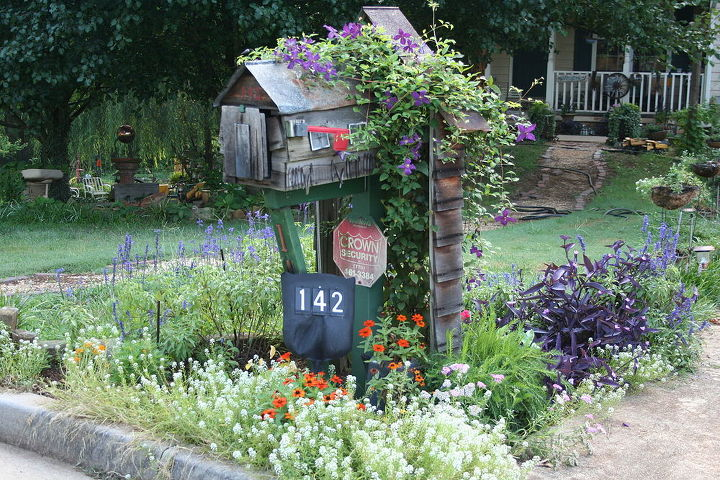 My mailbox in full bloom with address sign.