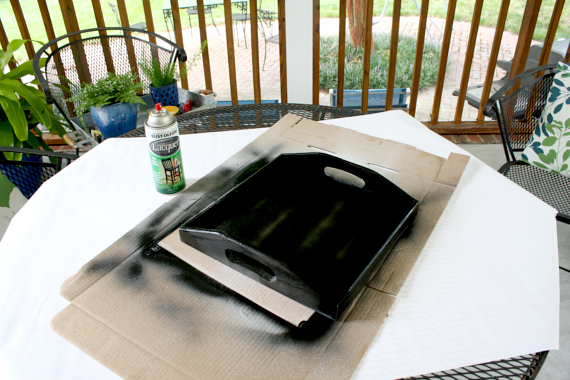 Paint over the tape with the black lacquer covering the entire tray.