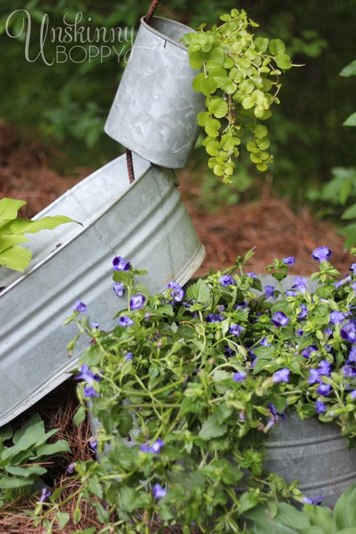 Stack the buckets and fill with thriller and spiller plants for maximum effect.