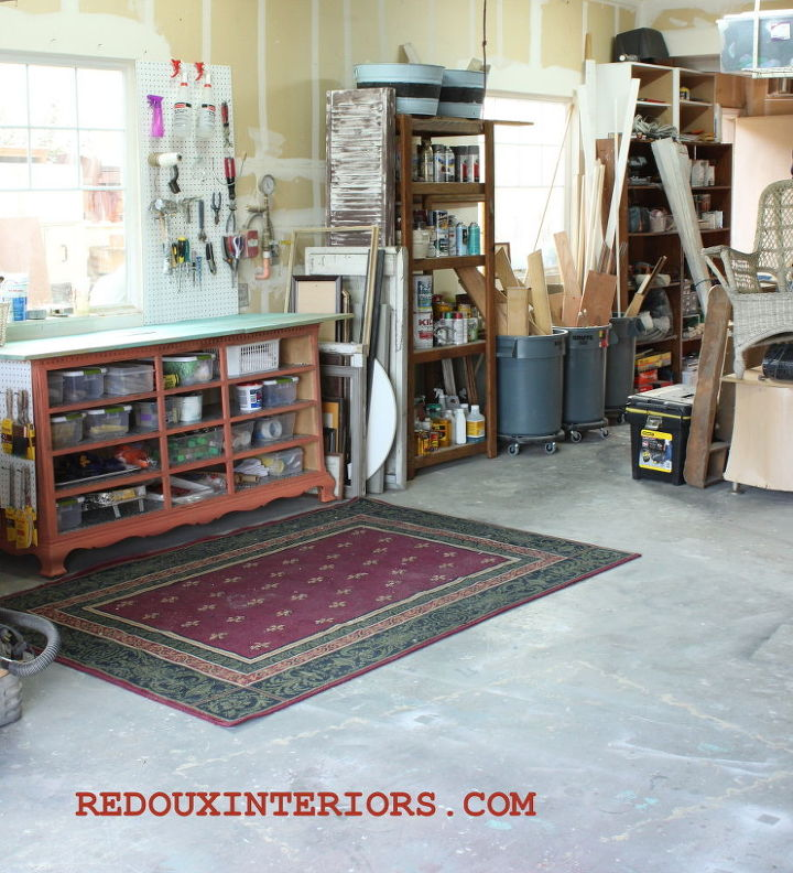 Organize your garage and control clutter without spending a fortune. Use upcycled items like this dresser without drawers, rolling garbage containers, and a dumpster dove area rug!