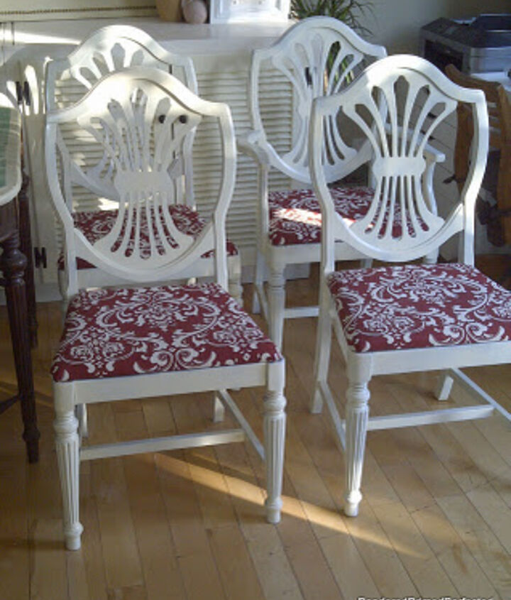 The chairs were spray painted a creamy white and the seats were recovered in some bargain graphic red and white fabric.