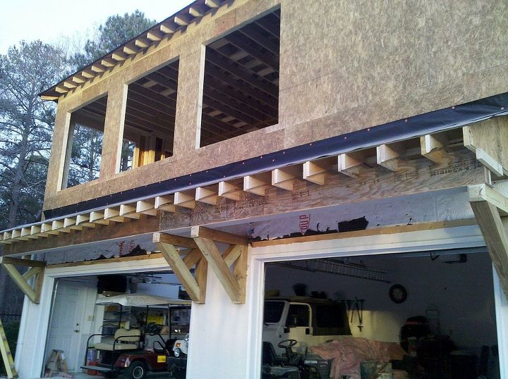 We added a home office over a three car garage. The awning beam is also installed above the garage doors.