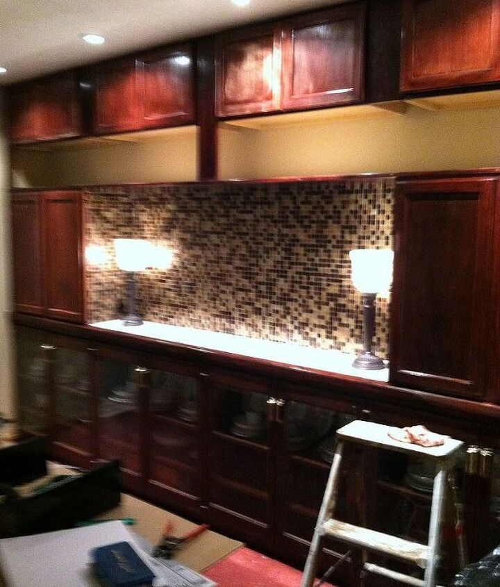 cabinets up and tile but on the back wall.
