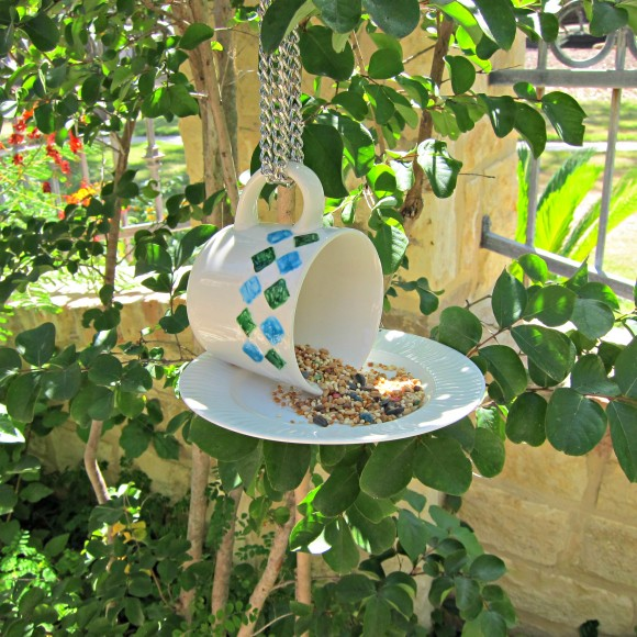 Here's the first bird feeder to go with the bird bath.  http://dollarstorecrafts.com/2013/07/tutorial-tea-cup-bird-feeder/