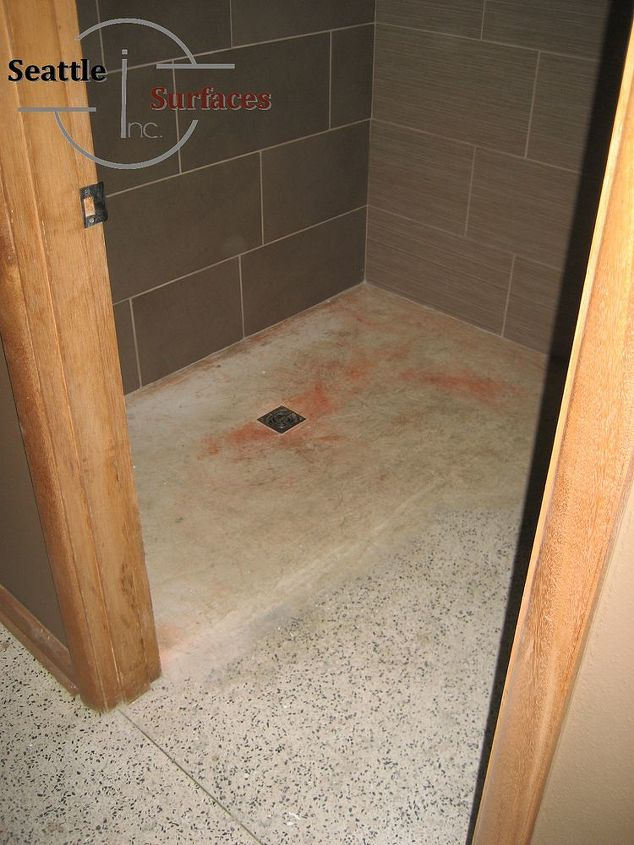 The tub was removed and a low profile shower pan was built and sealed with a polyurethane.