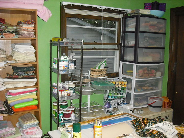 Next to bookcases, storage with my stamps, stencils, paint, etc.  I also have an antique chest under this storage, three drawers and I keep my fleece, flannel, fur, etc. heavy material in it.