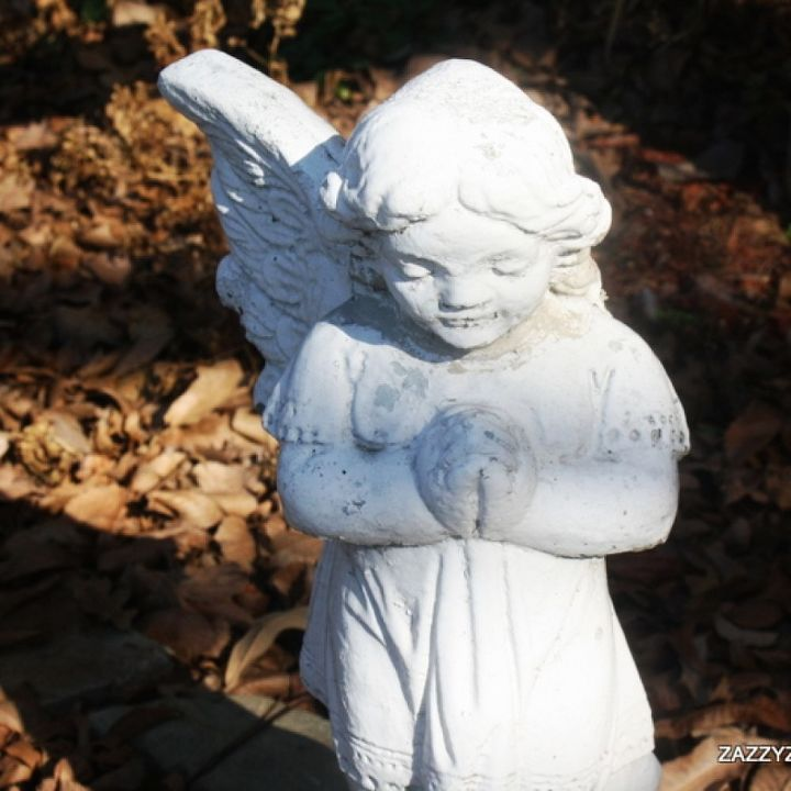 """My little wounded garden angel. She still stands guard and prays for this """" not by the book"""" gardener."""