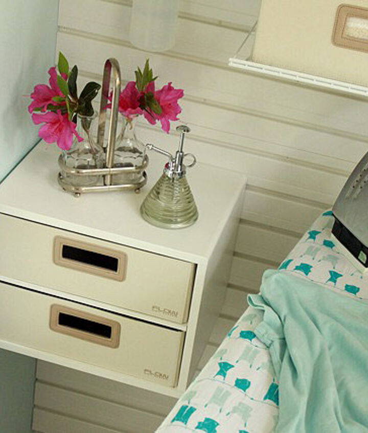 This little decor bin has clothespins and can act as an iron rest while ironing clothes.