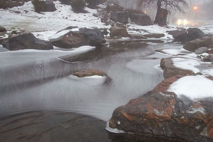 Winter Pond with Ice on a Foggy Morning