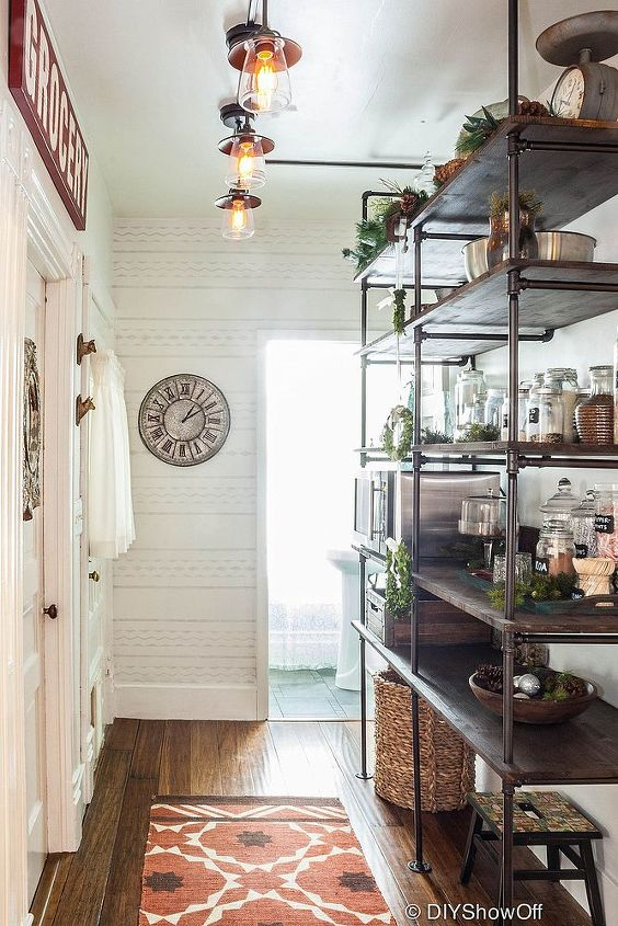 after: DIY industrial pipe shelving and an open pantry area