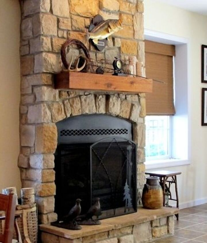 Fireplace with stone and cedar mantel.