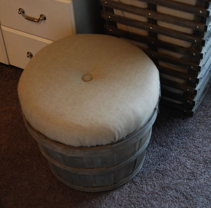 I made a padded top for this bushel basket by covering an old clock with foam and quilt batting. The center already had a hole so adding the little button to tuft the center was easy. It doubles as a seat and yarn storage.