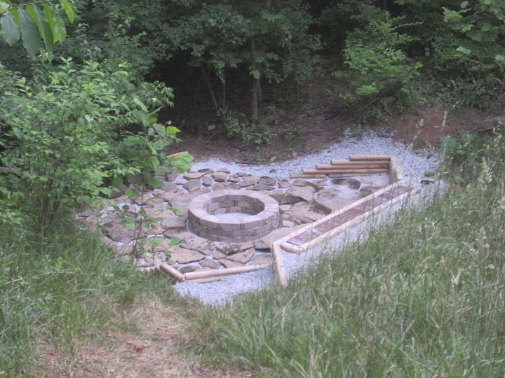 Next, he built the fire pit from pavers.  (A brochure at the store gave directions, dimensions, & told how many pavers we would need.)  Then he added the creek stone & filled the gaps in with pea gravel.
