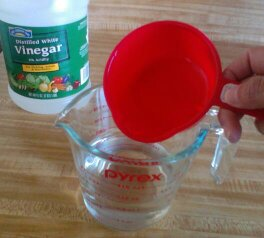 Step 1: Pour vinegar and water into a microwave safe measuring cup or bowl.