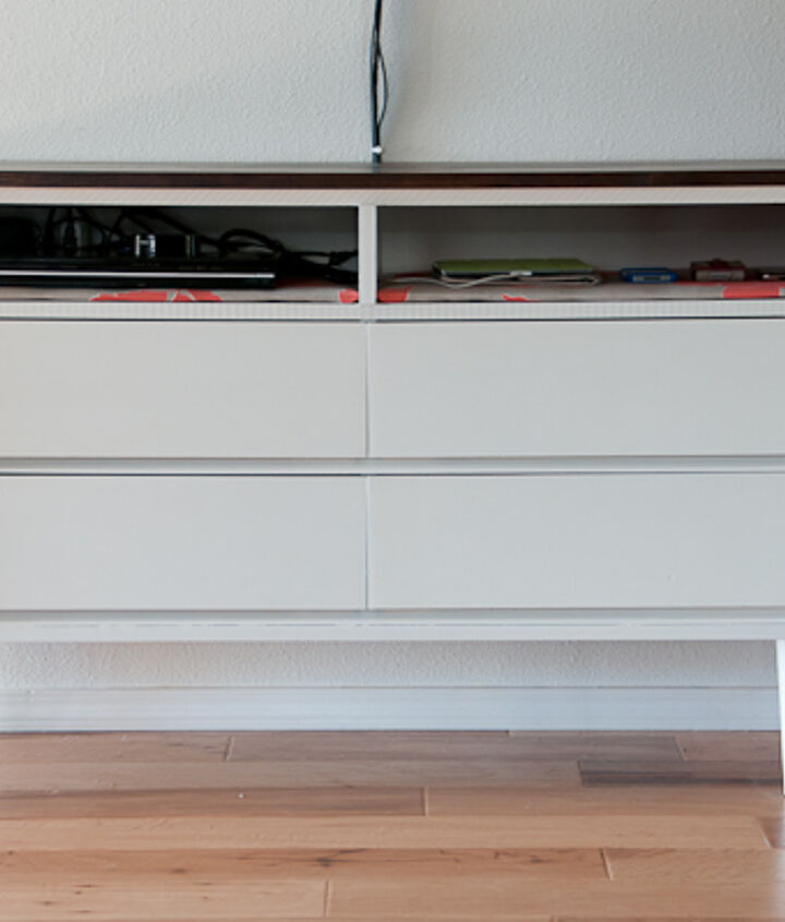 The top shelves, which I upholstered, hold electronics and a charging station.