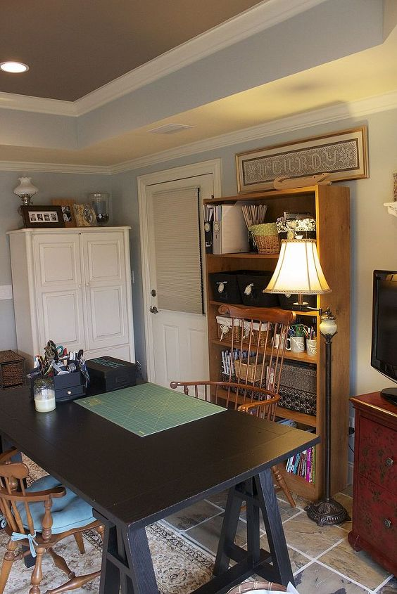 Pottery barn craft table, Son's old baby armoire that stores craft stuff. Office depot shelf (ick)