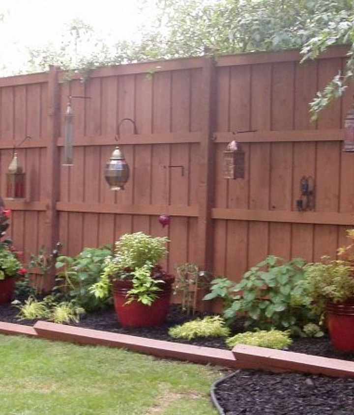 After - Backyard Fence w/ Lanterns & Red Pots