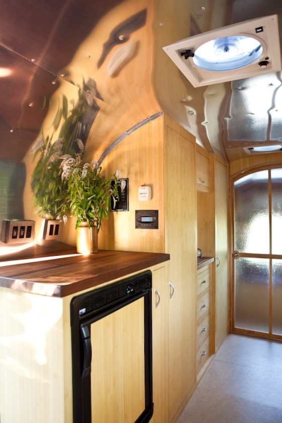 """The cabinets are constructed from """"plyboo"""" -- plywood made from bamboo.  All casing and trim was finished with tung oil and VOC-free solvents. Staining was done with VOC-free aniline dyes."""