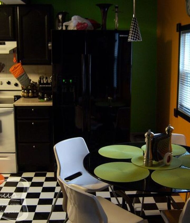 """The new view from the dining room/front door! The fruit-themed tiles have actually been covered with a """"tile tattoo"""" that is like a heavy duty contact paper, with a black and white pattern to match our new scheme."""