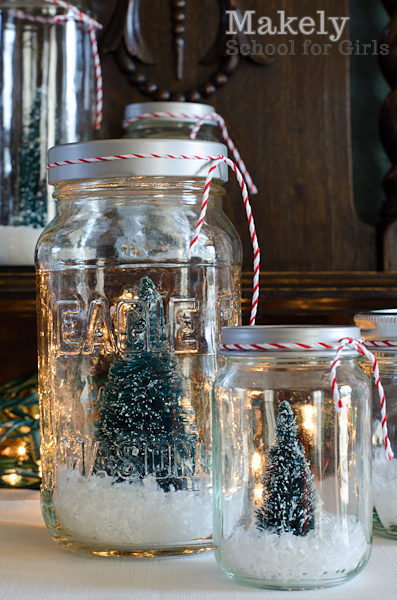 """3.  Then, my kids helped by pouring the """"snow"""" into the jars.  We used plastic flake snow in some and Epsom salt in others.  We put in enough to just cover the base of the tree."""