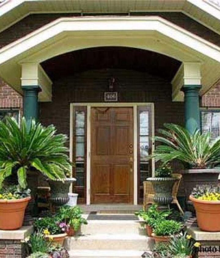 Stately plantings enhance this small bungalow porch. Photo courtesy of buyamac on Flickr.