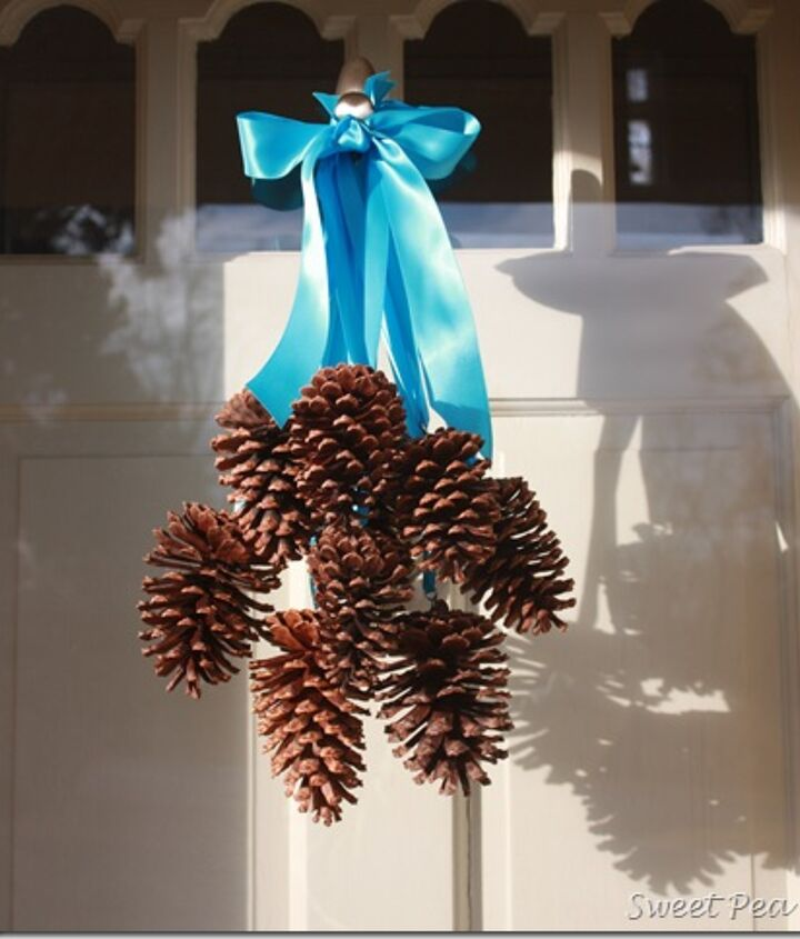 Pine cones hanging from individual ribbons make a pretty winter door decor.