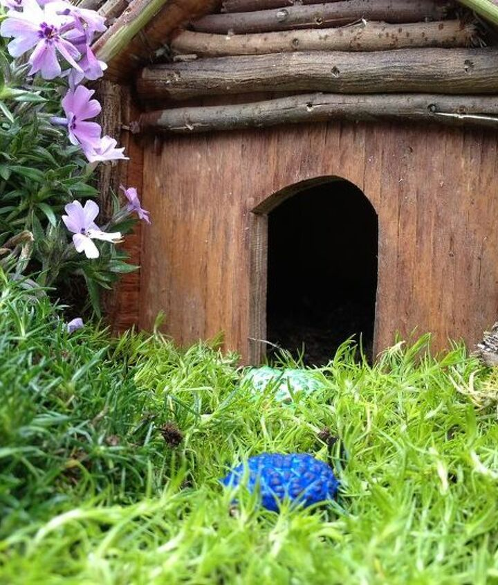 Nice and cozy for fairy visits. Made with left over wood from other projects (plus acorn tops for the roof)