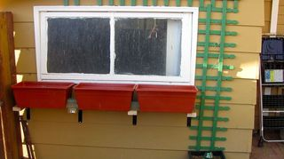 where can i find easy planter box plans to go under this window, flowers, gardening, This is what they looked like shortly after install before I painted wood and brackets to match the shed