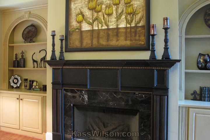The mantel makes the artwork more of a focal point.