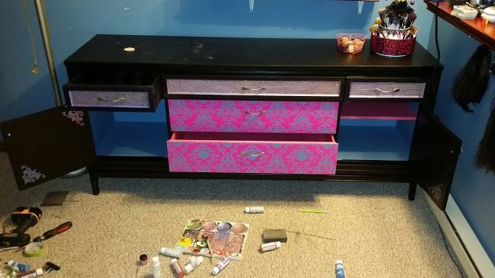 ran out of pink paint so used leftover wall paint inside the cabinets