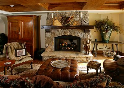 I found this picture on Houzz.com and I love the updated stone and mantel.  Can I add a mantel and get close to this look?  Should I color the stone in the tan family?  So confused.  :-)