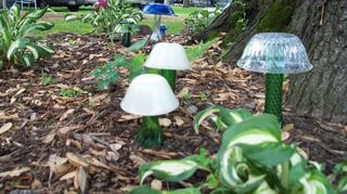 mushrooms and flowers for the garden and yard, crafts, Green glass stems with Fire King bowls pressed glass Other colors in background