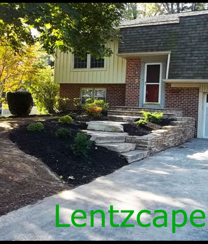 The homeowners are very pleased with their updated, yet natural new front entrance.