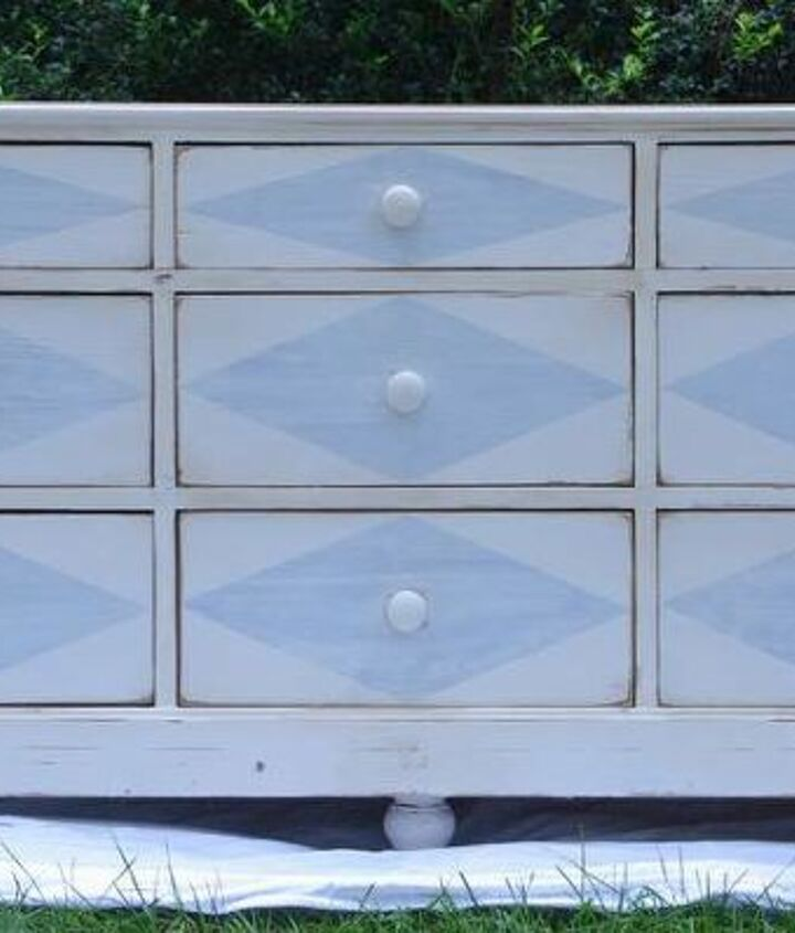 A straight-on shot of the painted dresser.  Antique white base with pale blue diamonds.  The drawers were simple with no embellishments and plain wooden knobs, so the diamonds worked... they had no competition.