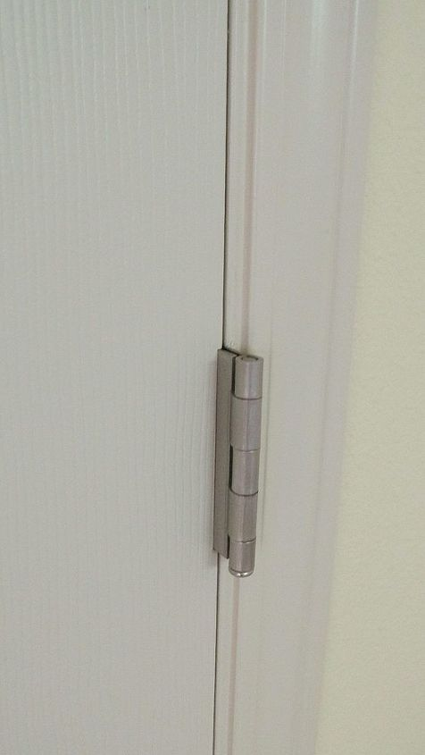 We replaced the old polished brass hardware with new satin nickel hardware on the doors.