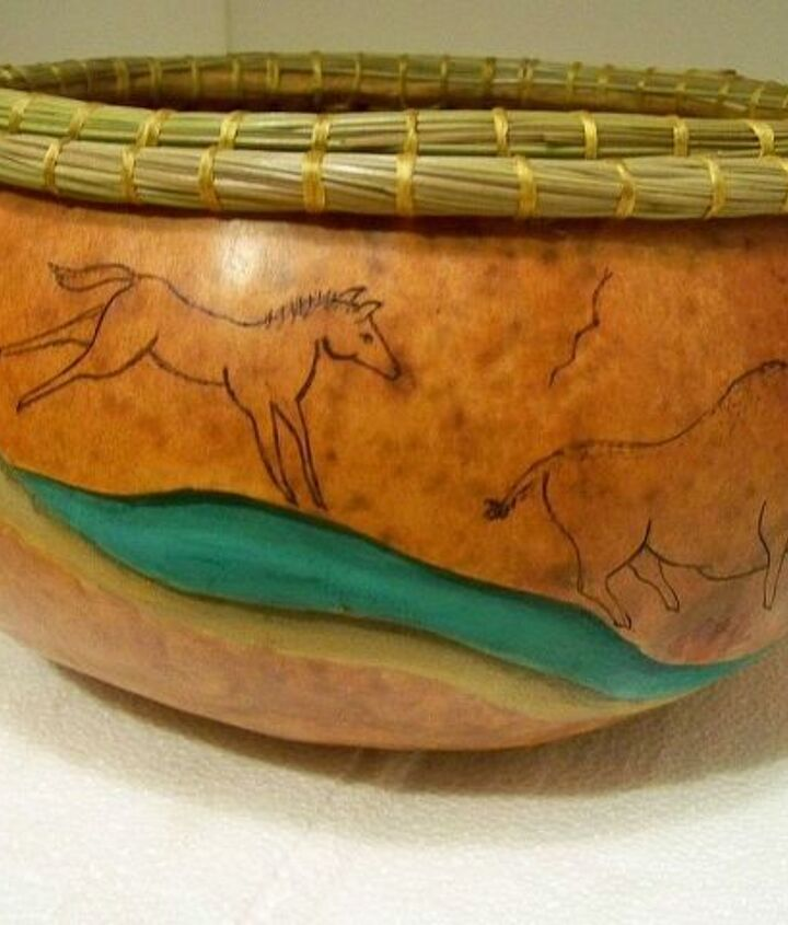 cave art. carved with wood burning and pine needle coiled rim.