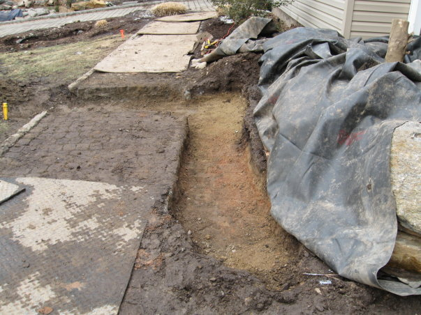 Excavation process taking place. Multiple liners had to be seamed together to make this work and function long term !!