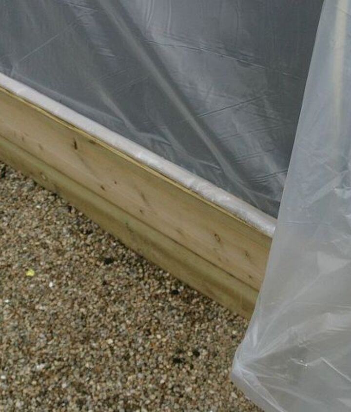 We attached the plastic along one 8′ side with nails and a thin strip of wood. Pull plastic over supports and secure with heavy stones or large pieces of wood to prevent it from blowing off.