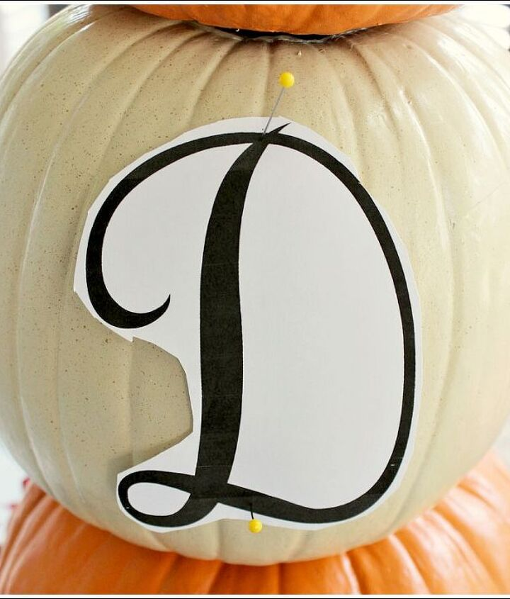 pumpkin topiary fall decorating ideas, container gardening, crafts, gardening, seasonal holiday decor, To add a monogram to your pumpkin print out a letter and use a few stick pins to hold it in place Take another stick pin and gentle poke small holes following the lines of your letter
