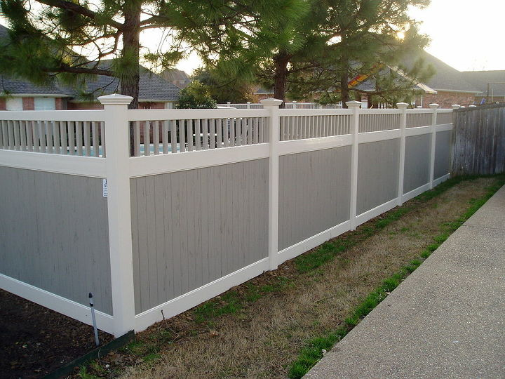 This is a Privacy Vinyl Fence with Classic Picket Accent