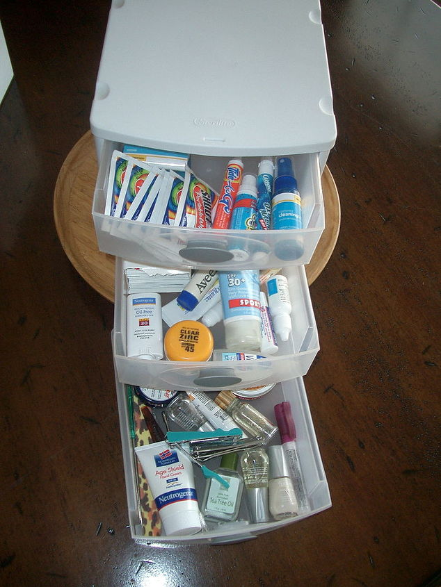 organizing tips for the bathroom, bathroom ideas, organizing, Metropolitan Organizing NC Small plastic stacks of drawers are perfect for organizing cosmetic related clutter Try one under the bathroom sink for various assorted items