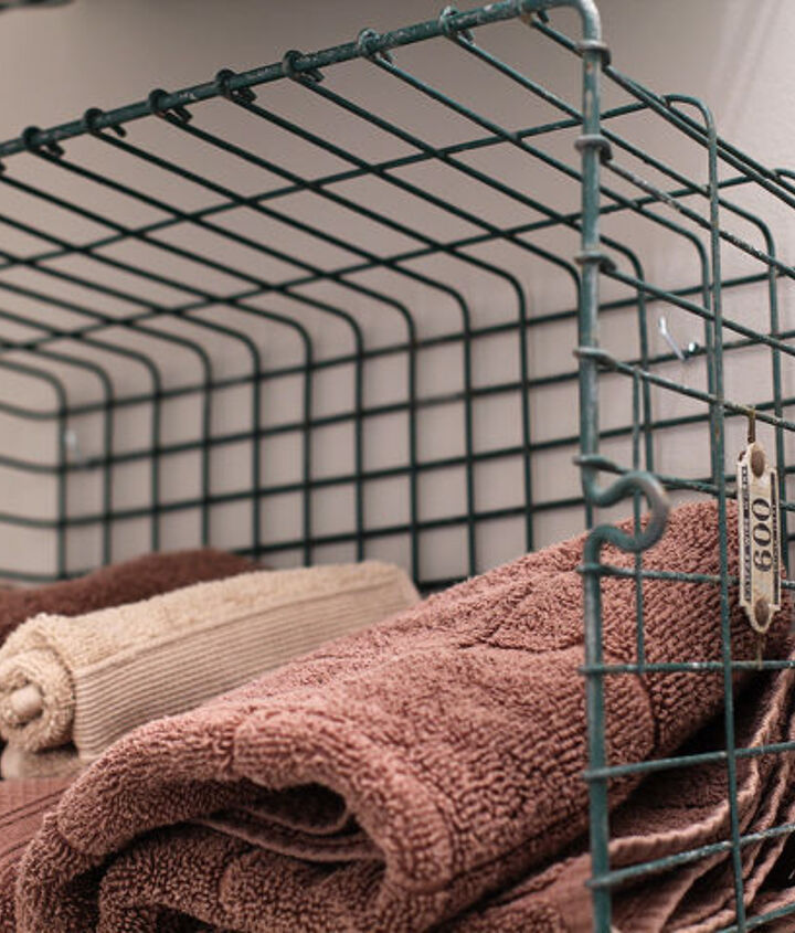Vintage locker baskets to hold towels and washcloths (sprayed them with poly to keep the old paint from flaking off)