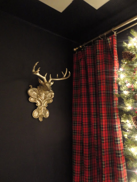 I love my deep navy walls and tartan draperies which I found at Goodwill for $8.  :-)