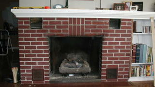 q what can be done to retain heat in room with brick wall and fireplace which lets in, curb appeal, fireplaces mantels, home decor, hvac, living room ideas