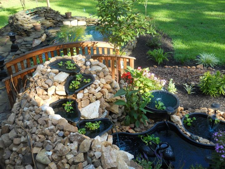 Same pond just bigger. Stucture was 4  1/2  feet tall and wrapped around the end with the 4 cascading tiers. Here is a pic of the finish in August 2011. The natural rock came from our ground from making flower beds and grading out our own driveway that was paved. We are on a rock vein here. Every shovel was a rock. Digging bar was our best friend. Unfortunately the earthquake collapsed it in August. Glad I had pics to remember it. It took a year and half to get all this rock from the ground and continuously add to it. I still have all of it and thinking I may just do another one in the back yard.