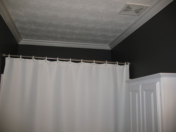 AFTER: New crown molding, curtain and paint.